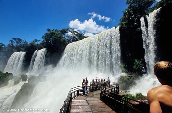 Patagonia South America >> Photo: Tourists standing on wooden walkway below falls, Iguazu - Scott L. Robertson Photography