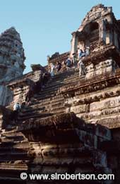 Climbing Temple Steps at Angkor Wat - Click for large image