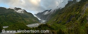 Sunlit clouds hanging over Franz Joseph Glacier