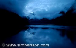 Clouds and water reflections in cool blue light after sundown, Doubtful Sound