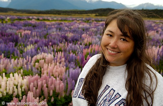 Young woman in field of lupines