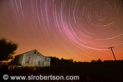 Sheep shearing shed and star trails with shadow of photographer, Kairuru Farm