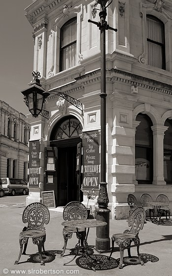 Victorian iron chairs and lamp post on corner at Criterion Hotel Pub, Oamaru