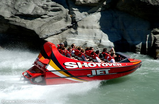 Jetboat navigating through gorge on Shotover River