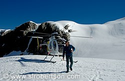 Helicopter on snow pack with pilot, Fox Glacier
