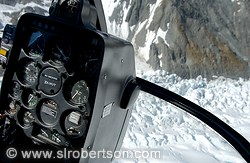 View from helicopter cockpit while flying over Fox Glacier
