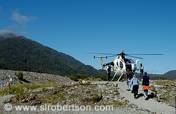 Couple preparing to board helicopter for aerial tour of Franz Joseph and Fox Glaciers