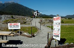Couple boarding helicopter for aerial tour of Franz Joseph and Fox Glaciers