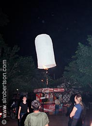 Launching a Candle-Powered Paper Balloon - Click for large image