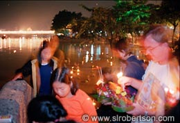 Lighting Candles on Krathong Boats - Click for large image