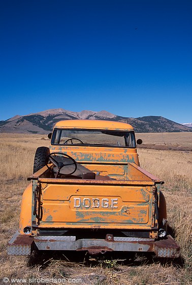 Photo Of Abandoned Orange Dodge Pickup Truck In Field With