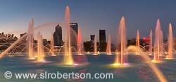 Lighted fountain and view of Jacksonville skyline at night, Friendship Park, Jacksonville, Florida