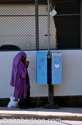Muslim Woman and Public Phone, Downtown Atlanta