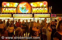 County fair food stall, night, large crowd of people