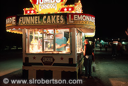 County fair food stand and customers - funnel cakes, corn dogs, cotton candy